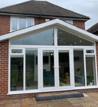 Gable-fronted solid roof extension